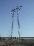 High voltage transmission structure - Guyed lattice tower